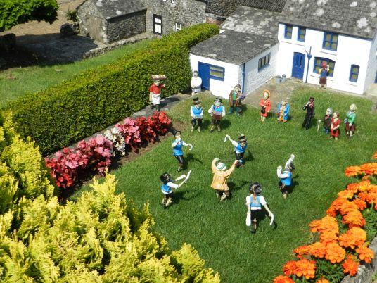 Miniature figures dancing